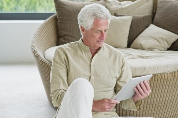 Senior man holding a digital tablet