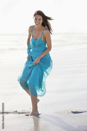 Beautiful laughing woman enjoying at beach