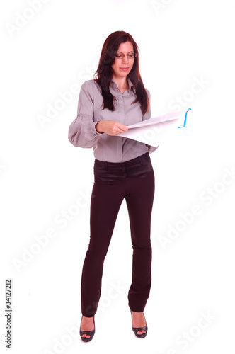 Young woman standing with file of papers