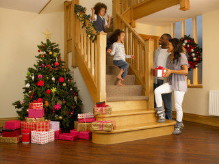 Young mixed race family on Christmas morning