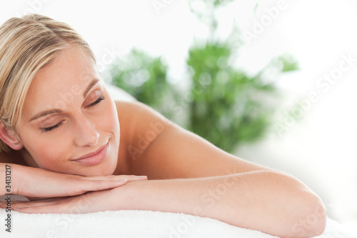 Close up of a woman lying on a lounger having a massage