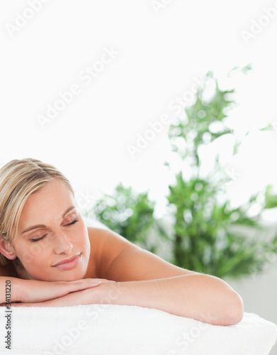 Close up of a cheerful blonde woman lying on a lounger