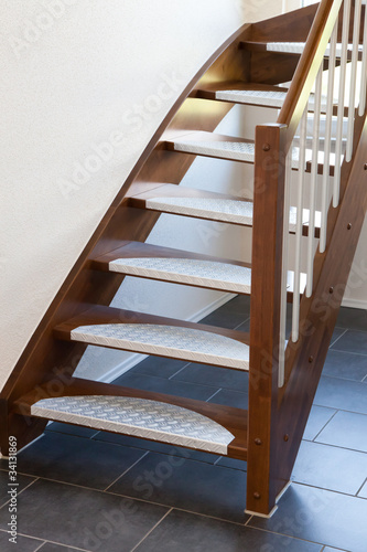 Leinwanddruck Bild Holztreppe mit Edelstahl