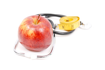 Red Apple with Stethoscope and Tape Measure