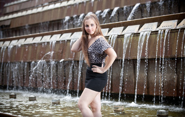 Beautiful caucasian model posing while standing in fountain