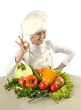 Attractive cook female with bunch of vegetables