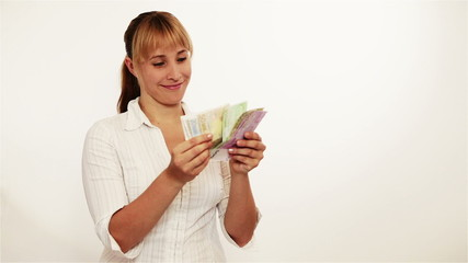 Attractive woman counting money