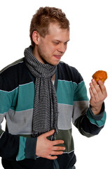 A young man in a gray-blue pullover keeps Tasty Cupcake