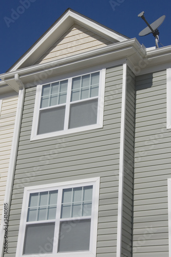 Detail of newly build townhome with a satellite dish