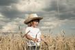 Blond boy in a field