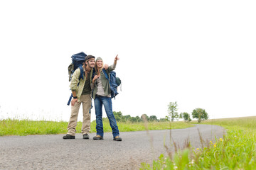 Hiking young couple backpack asphalt road countryside