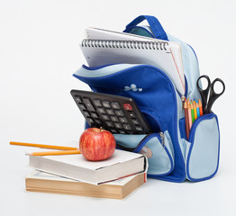 School Supplies with apple on white background