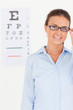 Good looking brunette eye specialist wearing glasses looking int
