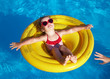 little girl swims in a pool