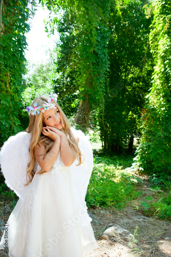 Angel children blond girl with sleeping hands gesture