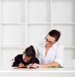 caring tutor teaching student