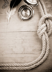 ship ropes and compass in sepia