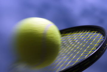 Speedy tennis ball on racket