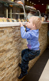 A boy is climbing on the bar