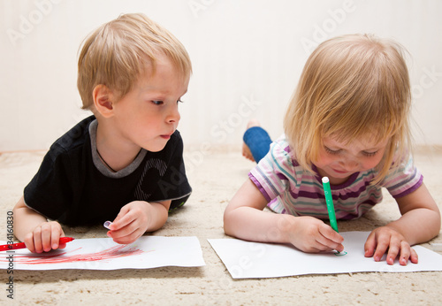 Boy and girl are painting