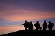 Leinwanddruck Bild - Silhouette of modern troops in Middle East silhouette