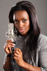 Portrait happy black woman singer in music studio
