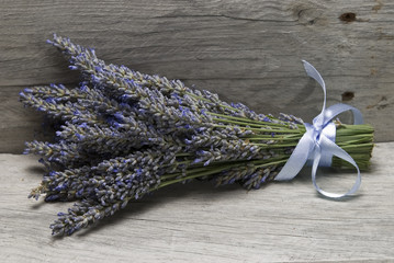 Bouquet of lavender on a shelf.