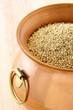 raw quinoa on copper pot