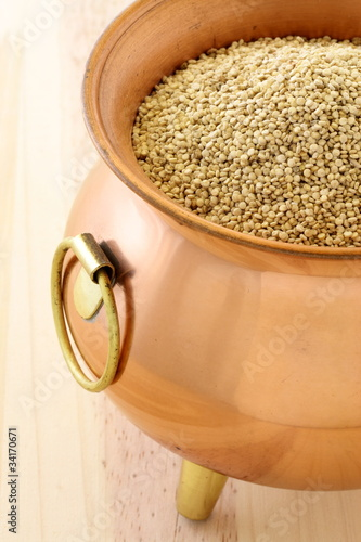 raw quinoa on copper pot