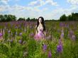 Lady in a flower meadow