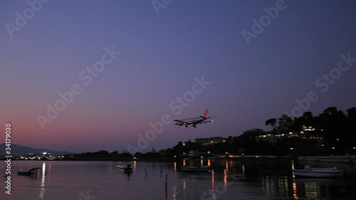 Landing of airplane, night scene, Corfu airport, Greece