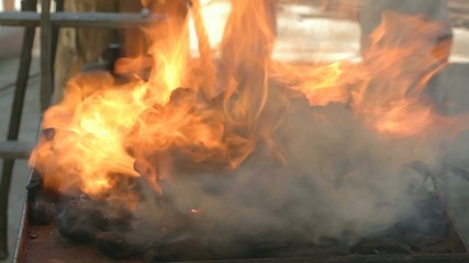 Close-up of fire flames from live coals blacksmith forge