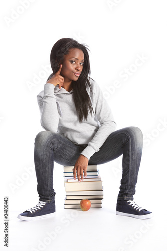 Black teenage student girl sits on education books