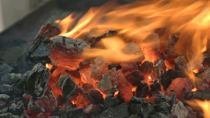 Close-up of glowing hot embers outdoors