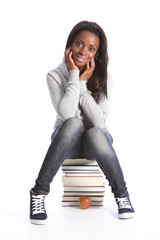 Happy young student girl with education books
