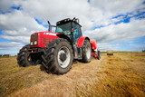 tractor collecting haystack in the field - 34184620