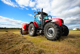 Fototapety tractor collecting haystack in the field
