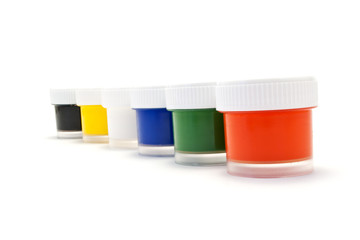 A set of colored paints in transparent plastic containers.