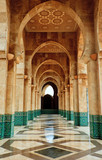 Intricate marble and mosaic archway outside mosque