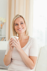 Portrait of a charming woman holding a cup of tea