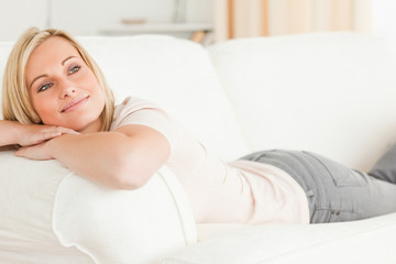 Close up of a woman lying on her sofa