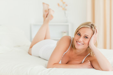 Calm woman lying on her bed