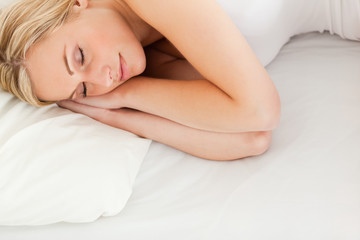 Calm blonde woman sleeping