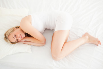 Cute blonde woman sleeping