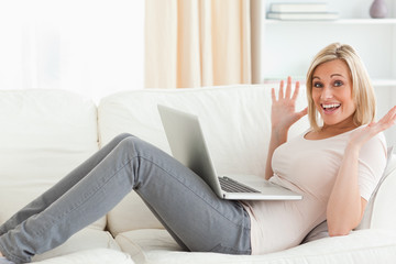 Amazed woman using her laptop