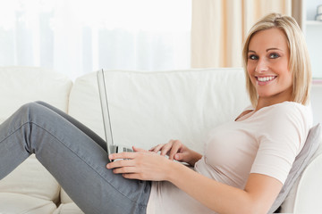 Blond-haired woman surfing on the internet