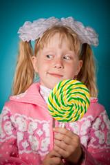 Crafty girl with big lollipop