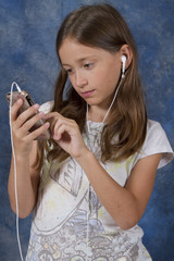 Young Girl Focused on Smart Phone Application