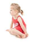 A little girl in red dress and barefooted