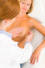 Plastic surgery doctor examine patient breast